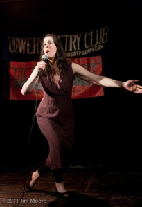 Shane Webb performing her stand up routine at Bowery Poetry Club