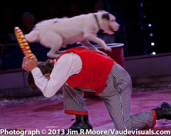 Johnny Peers performs with one of his wonderful dogs jumping thru a hoop for him.
