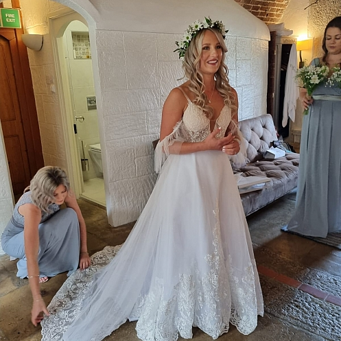 Real bride Immi Warren in bespoke designed and custom made to measure wedding dress by Holly Winter Couture