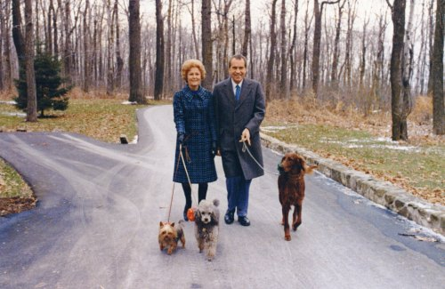Richard and Pat Nixon walk their dogs at Camp David (November 1973). Oliver F. Atkins photograph collection, Box 21, Folder 2. George Mason University. Libraries. Special Collections & Archives. Copyright not held by George Mason University Libraries. Restricted to personal, non-commercial use only. For permission to publish, contact Special Collections and Archives.