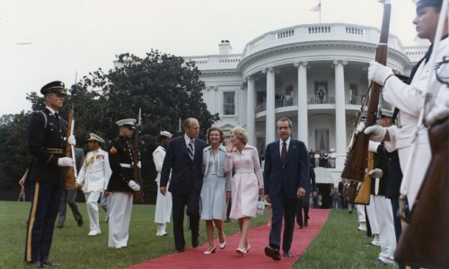The Fords and the Nixons walk across the White House lawn to the presidential helicopter Marine One  (August 9, 1974). Oliver F. Atkins photograph collection, Box 26, Folder 1. George Mason University. Libraries. Special Collections & Archives. Copyright not held by George Mason University Libraries. Restricted to personal, non-commercial use only. For permission to publish, contact Special Collections and Archives.