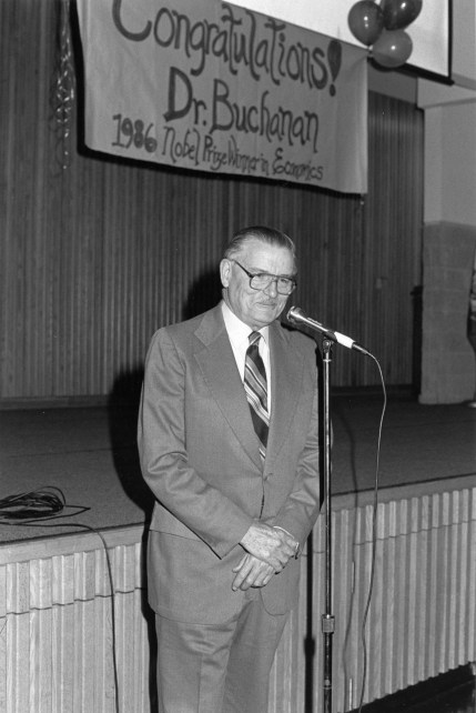 Dr. James Buchanan is seen here at a reception given in his honor at George Mason University. George Mason University photograph collection Box 16, Folder 6.