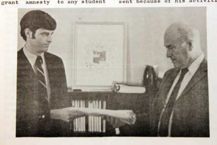 Student representative from the George Mason College Vietnam War Moratorium Committee presents Chancellor Lorin A. Thompson with petition asking college administration to excuse members of the campus community from classes on October 15, 1969. From The Gunston Ledger, Volume 7, Number 4. October 14, 1969.