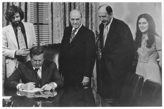 Governor A. Linwood Holton, Jr., signing H-210, the bill which separated George Mason College from its parent institution, University of Virginia.