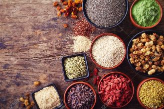 39376995-Bowls-of-various-superfoods-on-wooden-background-Stock-Photo-superfoods