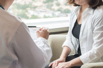 woman with doctor going over cervical cancer screening