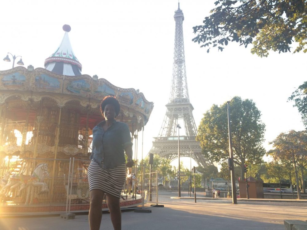 Eiffel Tower black solo traveler. how do solo travelers get such good pictures https://vaycarious.com