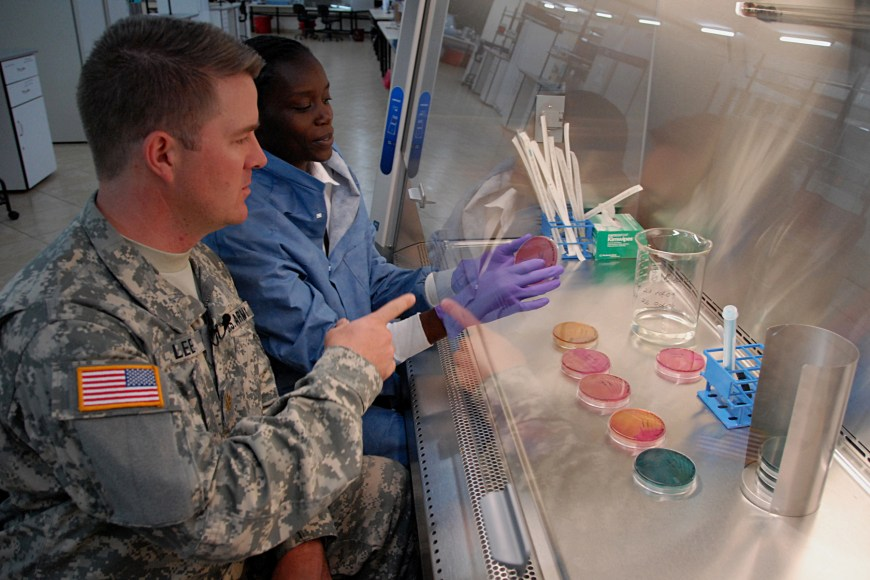 A Servicemember visits a research lab.