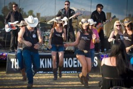 Line dance fans boot scoot to a performance by The Walking Phoenixes at OakHeart 2015.