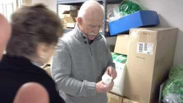 Dr. William Kelso examines the Bartmann jug fragment replica.