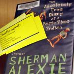 Cover of Alexie novel with a yellow slip challenging it