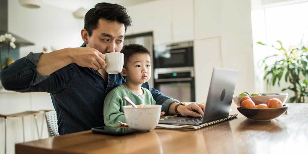 Man with Son while working on laptop