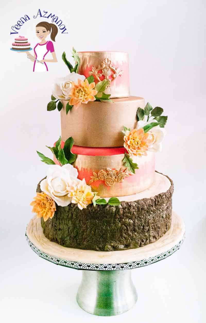 Dahlia Gold Wedding Cake   Veena Azmanov   us91 This Dahlia Gold wedding cake is four tiers of deliciously flavored cake  from creamy coconut