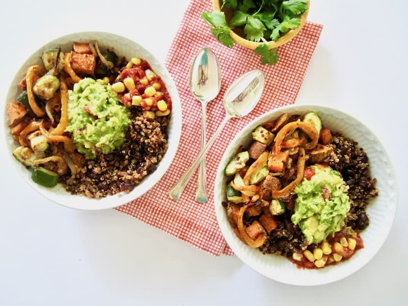 These vegan Southwest Veggie Burrito Bowls are an easy meal your whole family will enjoy! The quinoa and black bean base pack each plate with 13 grams of plant based protein. Top the bowls with homemade guacamole for super fresh flavor. Great for dinner, leftovers and as lunch the next day!