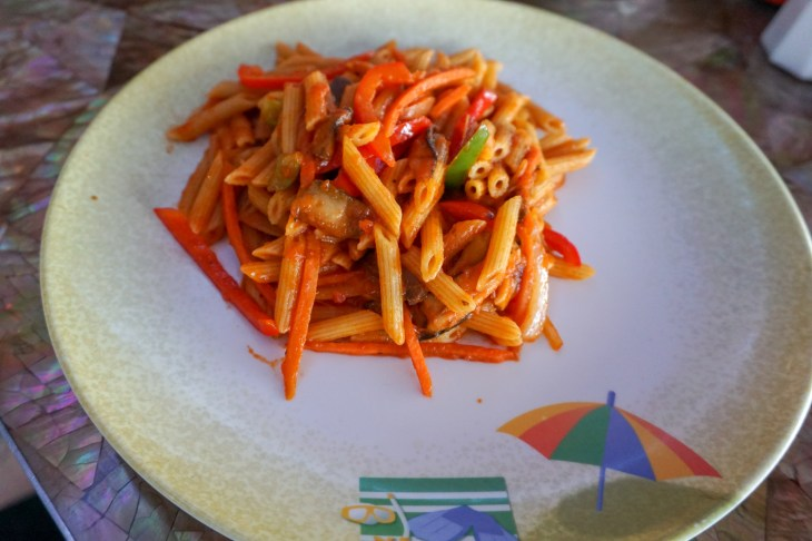 Penne noodles with peppers in tomato sauce