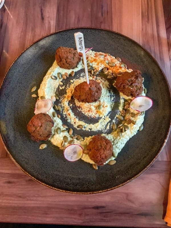 5 pieces of falafel on hummus