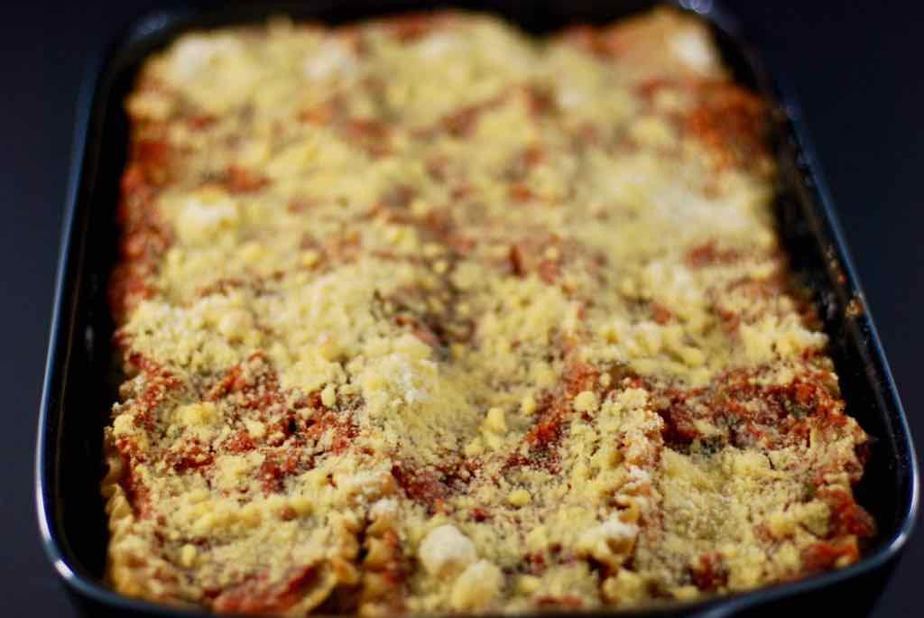Lasagna in pan with salad