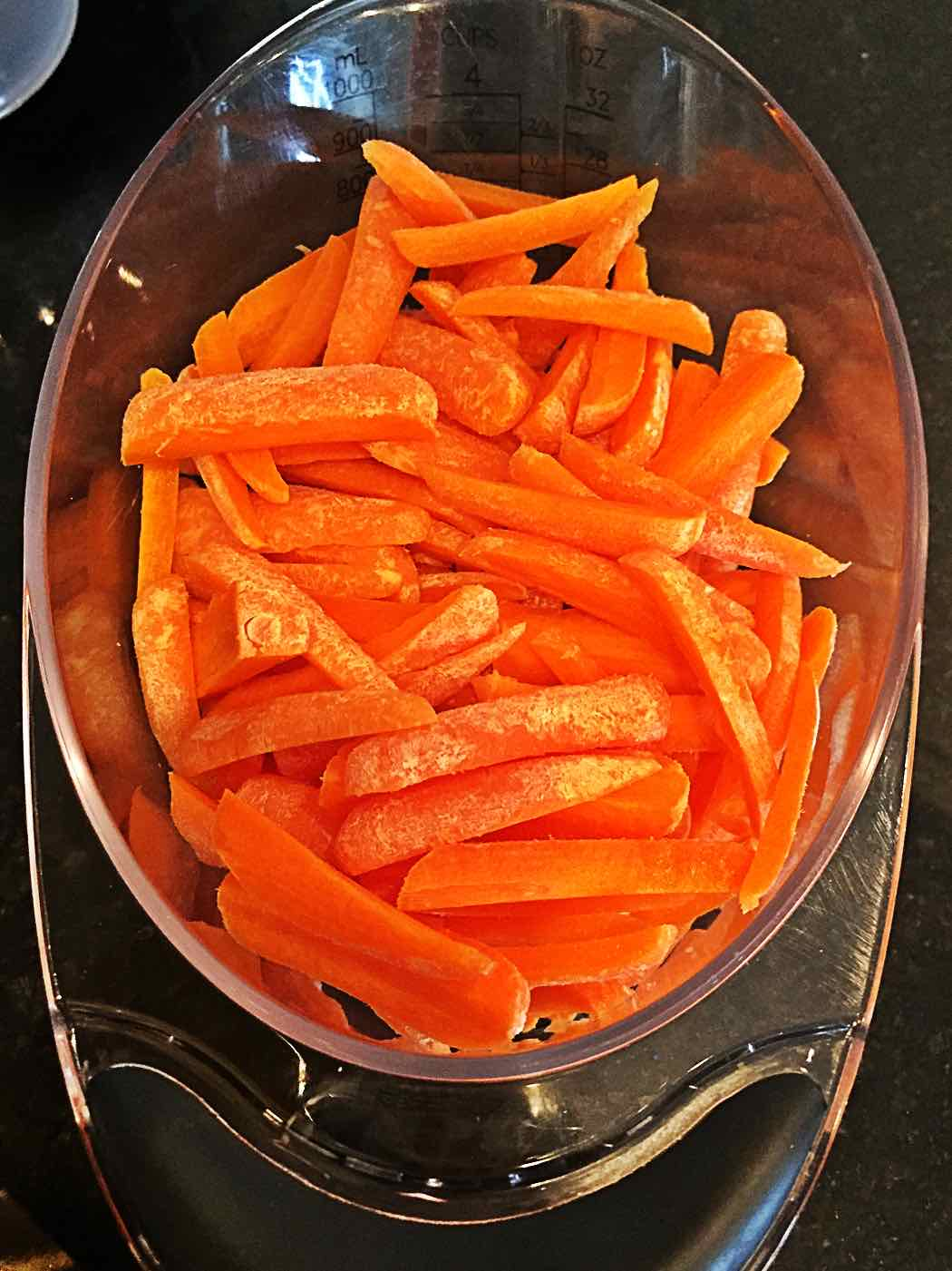 Matchstick carrots in measuring cup - VeganEnvy.com