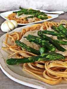 Image of Creamy vegan pesto white sauce on linguine pasta with asparagus.