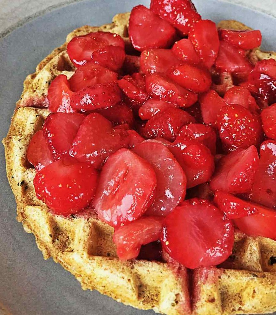Image of a vegan whole grain waffle with strawberries.