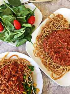 Plates of spaghetti with meatless vegan healthy tomato sauce.