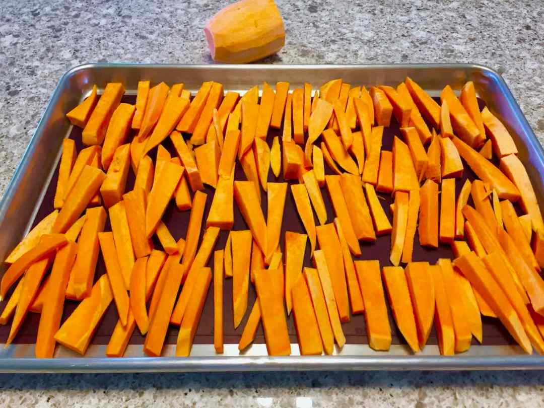 sweet potato fries in sticks ready for baking
