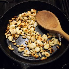 dry-roast almonds and pine nuts