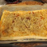spread softened onions across interior of pastry