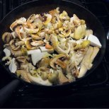 spread mushrooms in wide pan with 2 tbs. olive oil