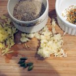 grind the seeds, mince the garlic and finely grate the ginger, bruise cardamom pods and crush seeds