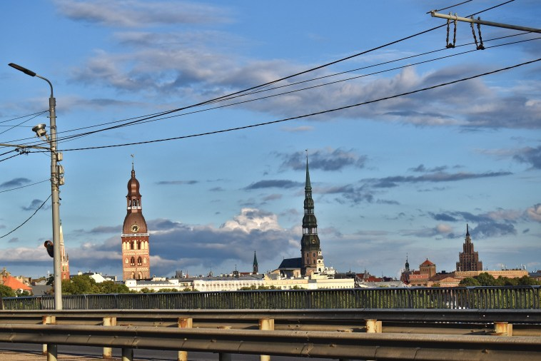 view of old riga church towers and the panorama tower from a bridge