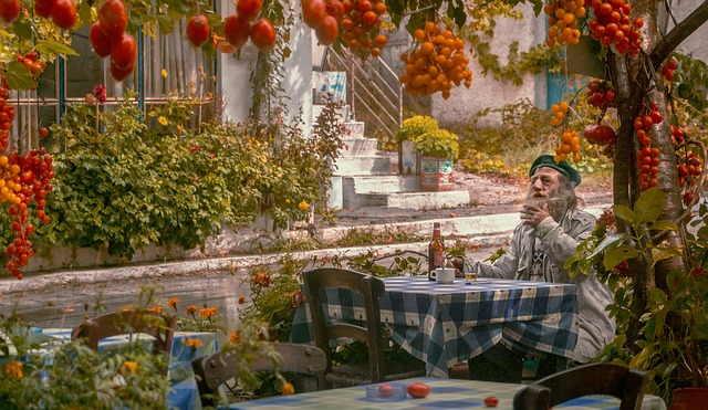 Man at restaurant surrounded by tomatoes