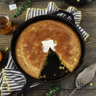 This Sweet Skillet Cornbread Recipe will have them running to the dinner table. It's lightly sweetened & moist on the inside with a crispy & buttery outside. Thanks to the cast-iron.