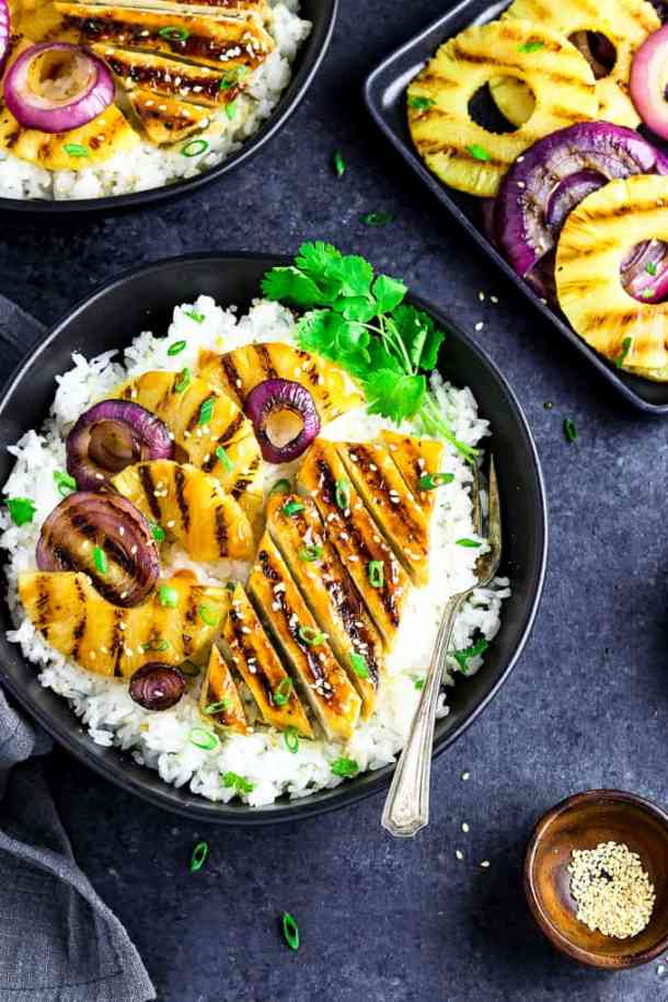 overhead view of a teriyaki bowl with grilled pineapple and onions on the side.
