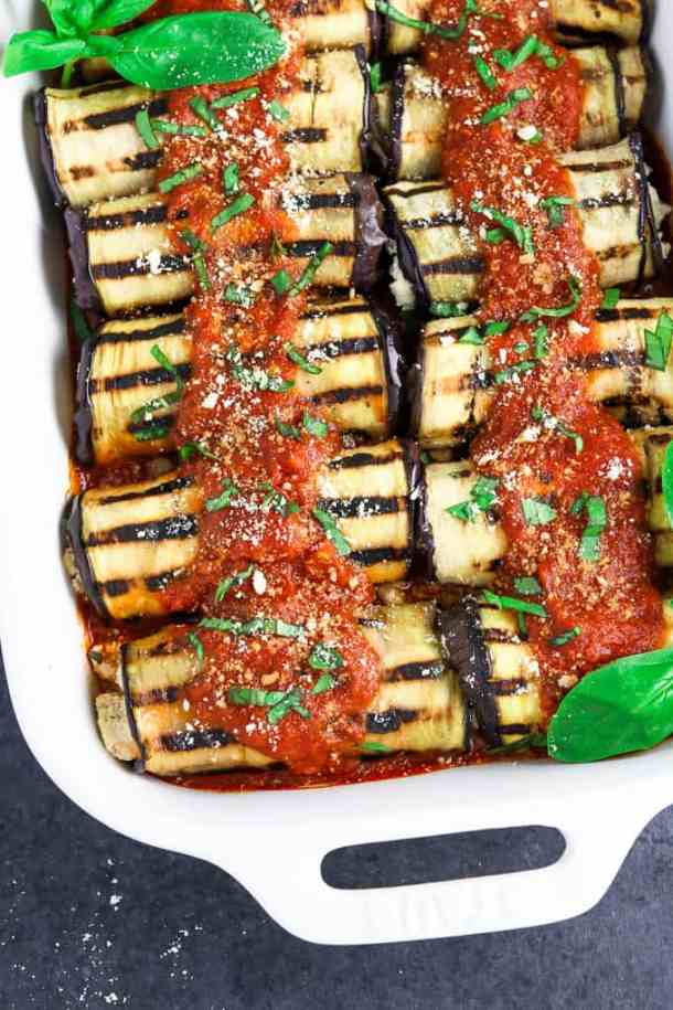 Casserole dish filled with fully cooked vegan eggplant rollatini.