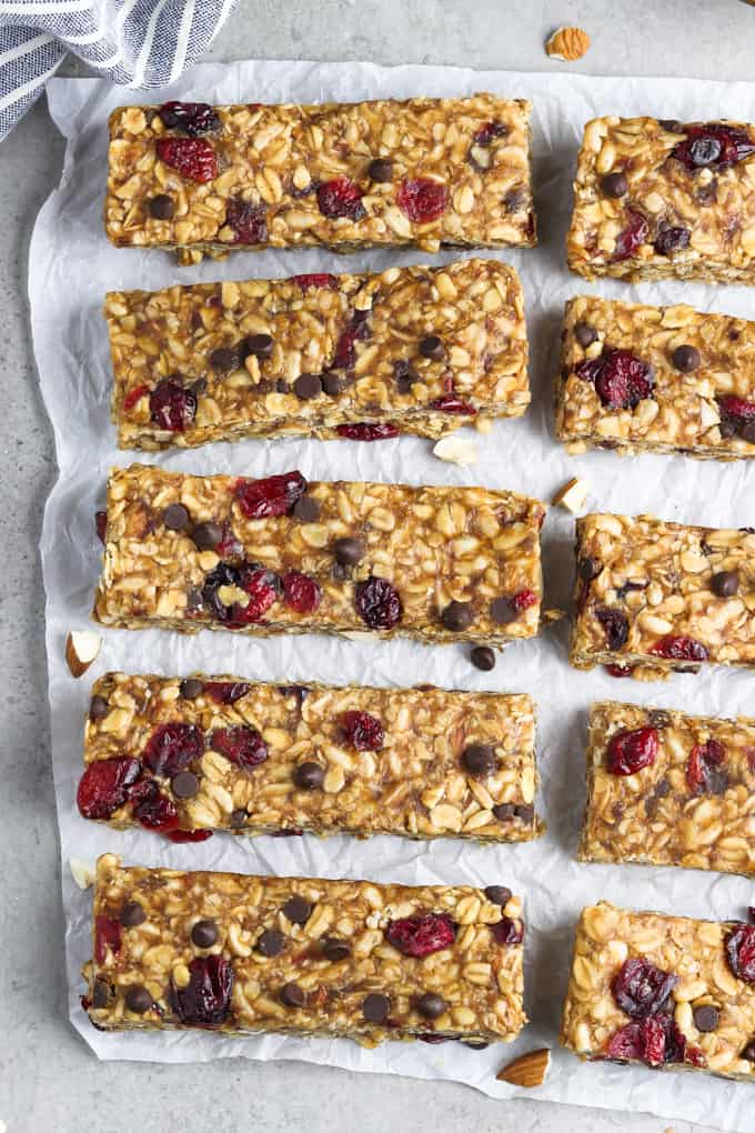 overhead view of 8 vegan granola bars on parchment paper.