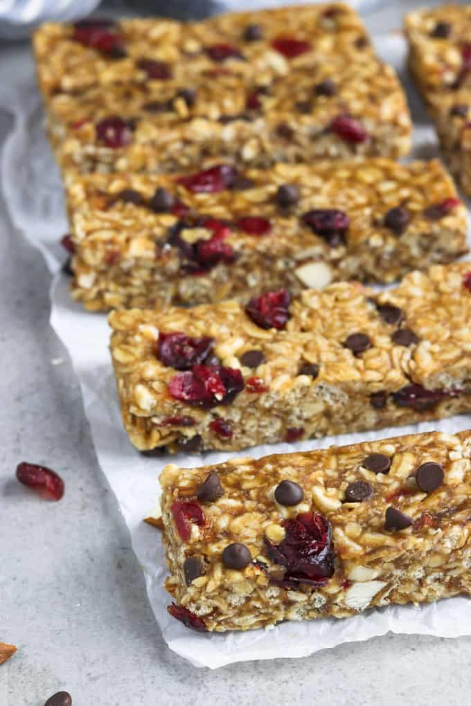 side view of vegan granola bars on parchment paper.