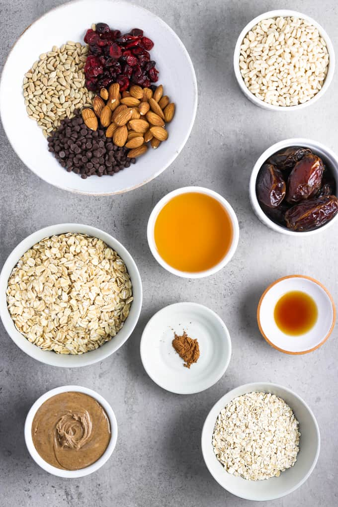 Ingredients for no bake granola bars on a stone table top.