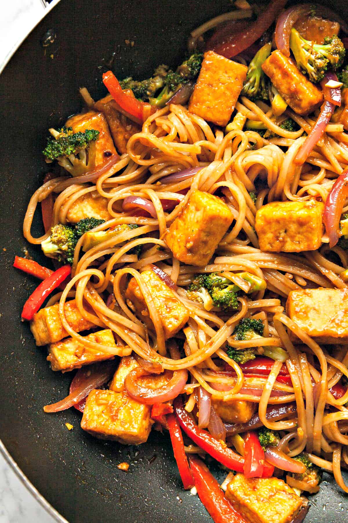 Close up view of fully cooked stir fry in a wok.