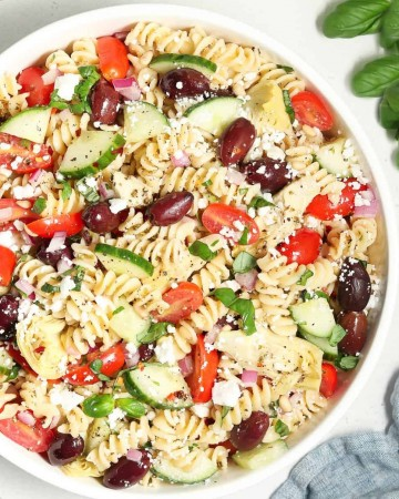 close up view of Mediterranean Pasta Salad in a white bowl.