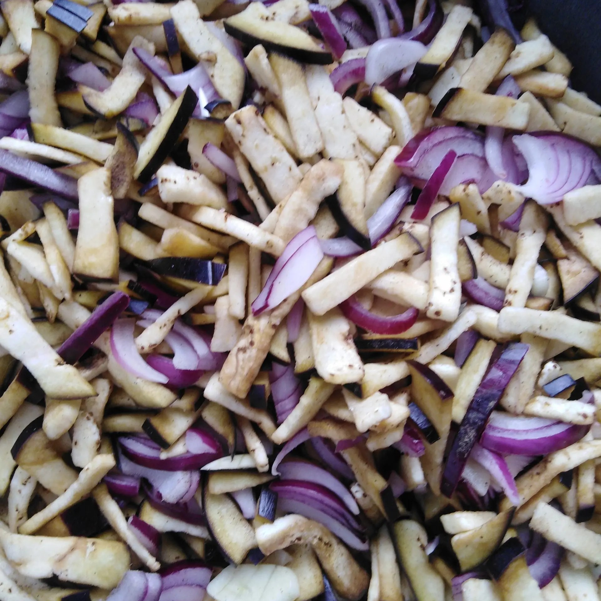 Mixed ingredients for Vegan Swiss Potato Fritter Stuffing: red onions, eggplant and garlic