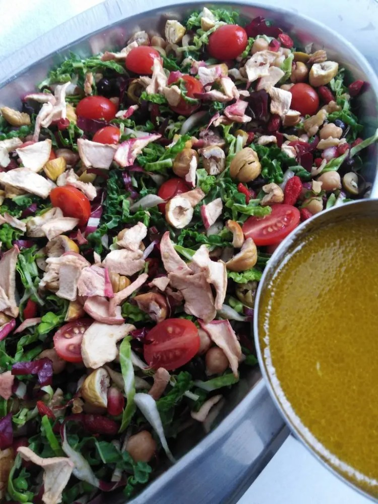 winter salad with healthy salad dressing on the side