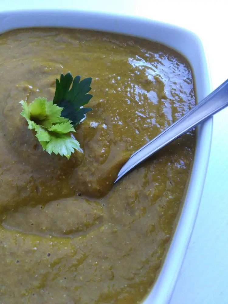 Close up of lentil soup on a bowl with a spoon