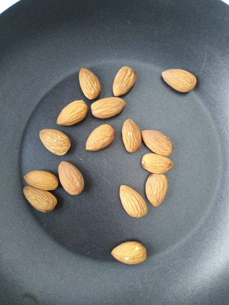 almonds on a frying-pan