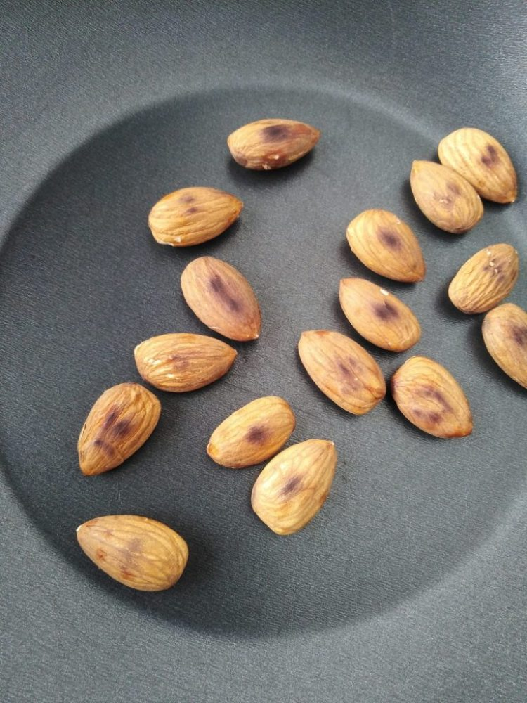 toasted almonds on a frying-pan