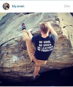 Evan climbing in his Vegan Outdoor Adventures shirt
