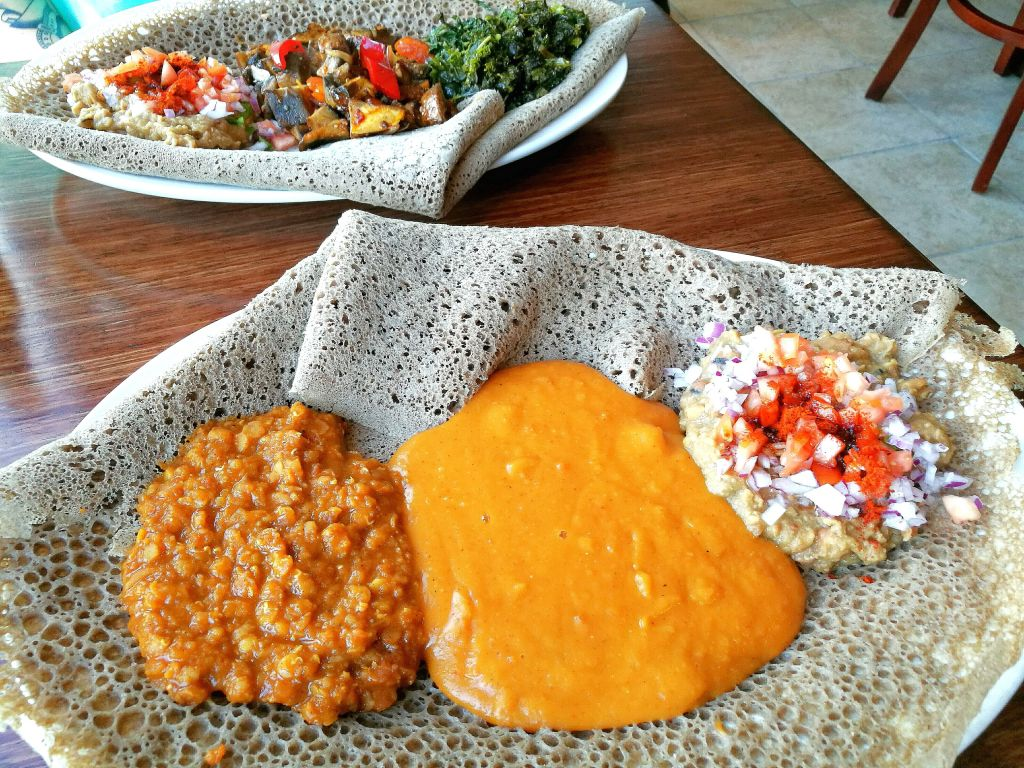 Vegan Ethiopian Food Consisting of Different Colored Curries
