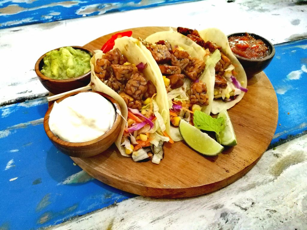 3 tacos with guacamole and sour cream