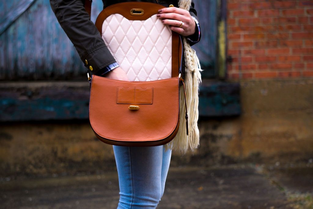 Girl wearing vegan PU leather handbag