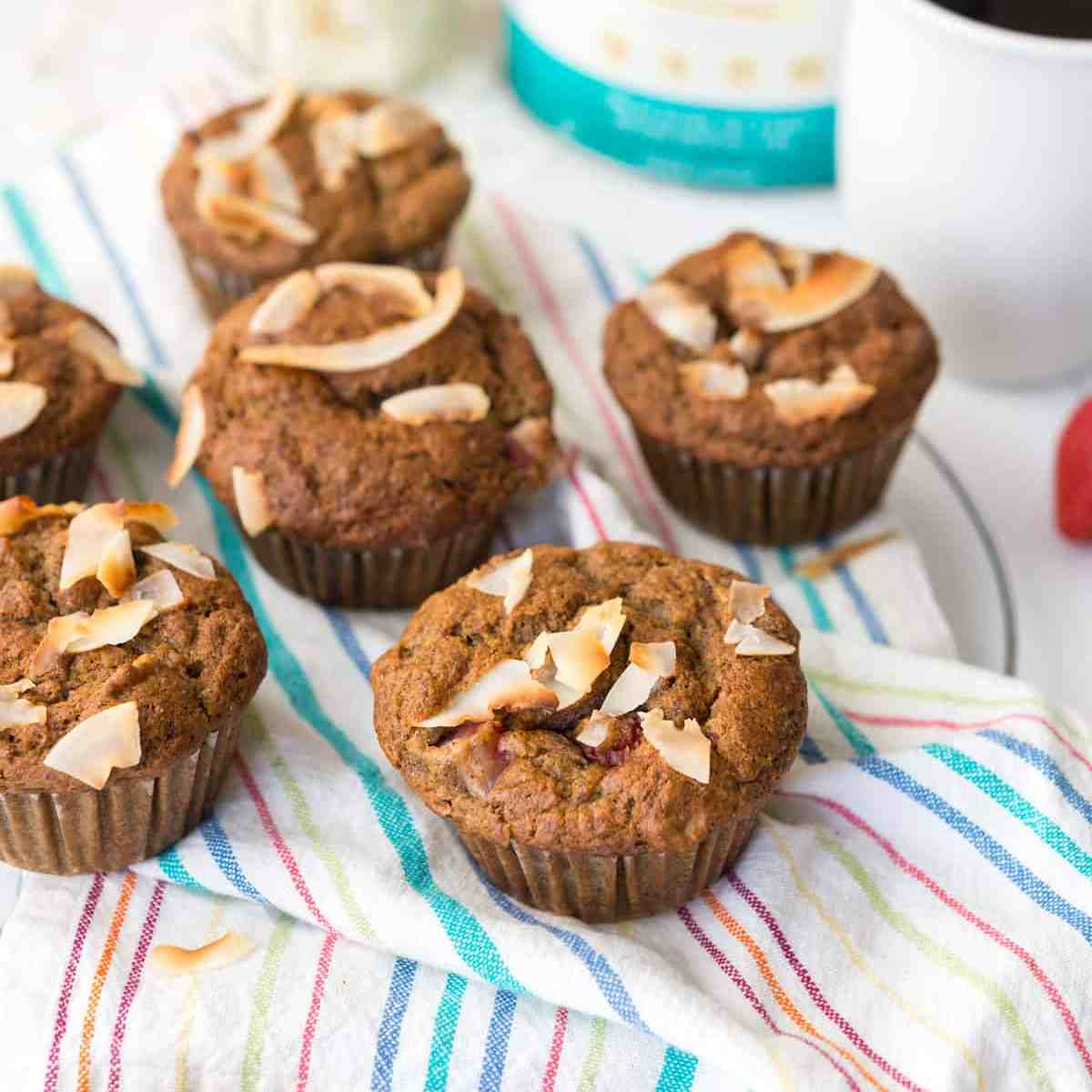 Whole wheat muffins bursting with banana and strawberry flavors, filled with walnuts and plant-based protein. The perfect breakfast! #vegan